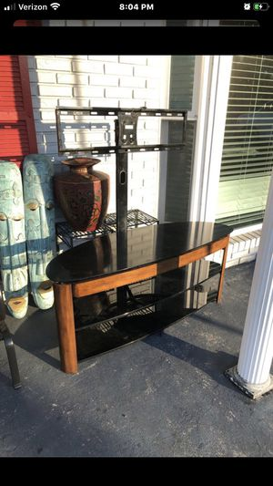 Three shelve tv stand needs cleaned but solid found in storage unit for Sale in Tampa, FL