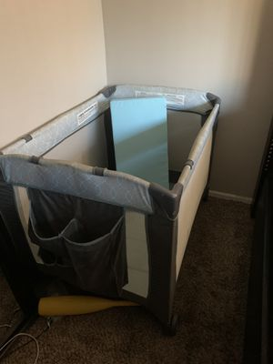 Playpen with extra padding and changing table attachment for Sale in Stanton, CA