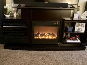 Brown wood TV stand with fireplace for Sale in Lexington, KY