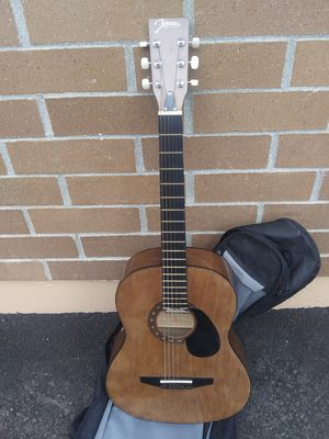 Johnson acoustic guitar with back pack case plays great for Sale in Marysville, WA