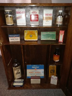 Antique Medicine Cabinet with vintage medical supplies for Sale in Mead, WA