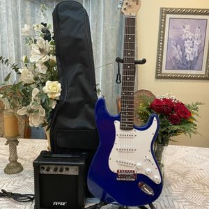 blue huntington electric guitar with case amp cable and astrap for Sale in Commerce, CA