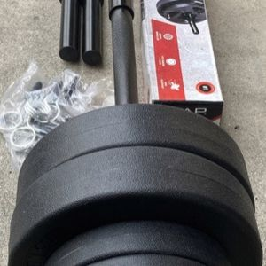 Weights standard 1 inch straight bar and 40lbs of vinyl plates with dumbbell handles for Sale in Covina, CA