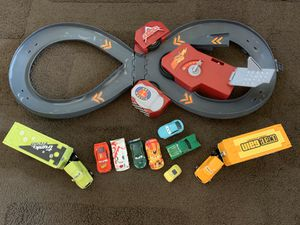 Disney cars lot and race track (works) for Sale in Rialto, CA