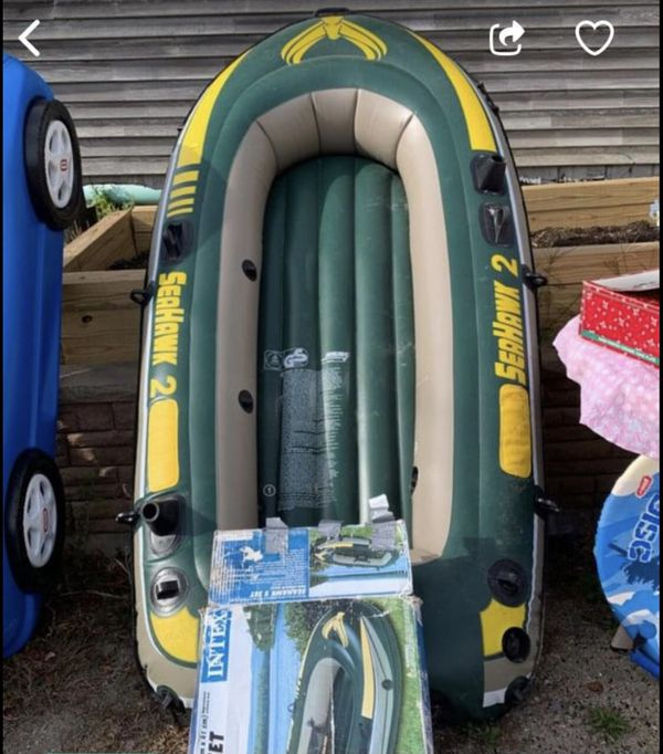 Brand new never used Inflatable boat comes with oars