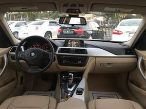 """BMW 320i COUPE """"LOW MILES/RED INTERIOR$2999DOWN$300MONTLYW INS-$13999(7414 N FLORIDA AVE PLEASE ask for Toris luxury auto mall"""