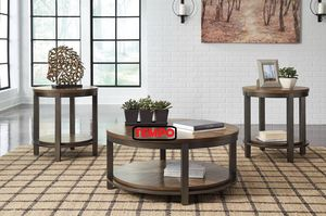NEW IN THE BOX. ROYBECK LIGHT BROWN/BRONZE OCCASIONAL TABLE SET (SET OF 3), SKU# T411-13TT for Sale in Garden Grove, CA