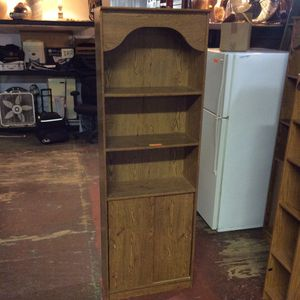 Pair Wooden Style Bookshelves With Sliding Doors for Sale in Bellingham, MA
