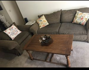 Moving out soon .selling Living room set of large heavy sofa with oversized chair and free coffee table with 3 pillows still available for pick up for Sale in MONTGOMRY VLG, MD
