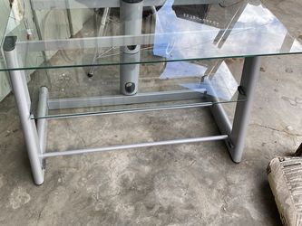 Bell'o tv stand/entertainment center with 3 glass shelves can be used as a coffee table as well for Sale in Dinuba,  CA