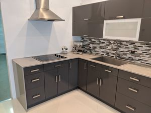 Kitchen cabinets will countertop, sink and stove. for Sale in Oakland Park, FL