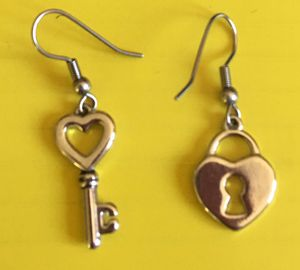 Lock and key pieces earrings silver toned . Pick up or I will ship too for Sale in Strongsville, OH