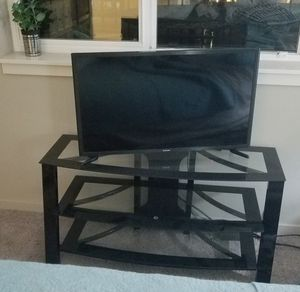 Beautiful TV stand with smoke glass and beautiful black laquer trimmings. Practically new, no scratches. for Sale in WA, US