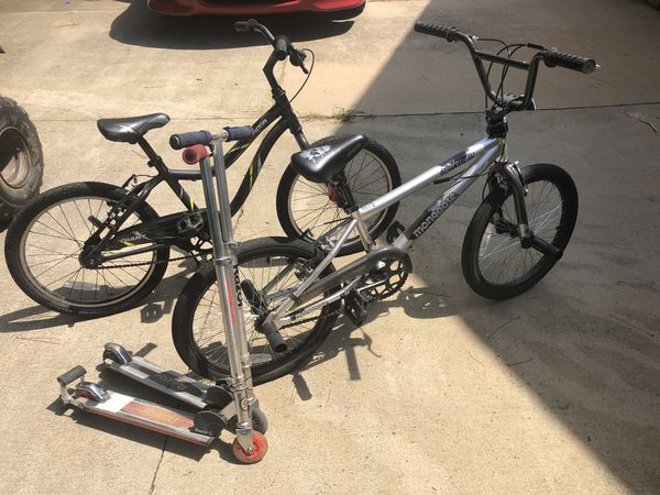 Boys BMX bicycles and razor scooters