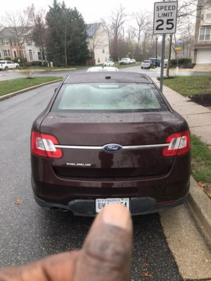 2010 Ford Taurus 72k miles red royal leather interior for Sale in Elkridge, MD