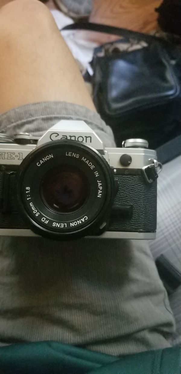 Canon AE-1 with lenses.