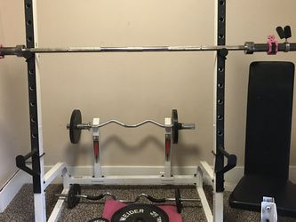 Home gym: squat rack with Olympic barbell weight set, curl bars, adjustable dumbbell set and adjustable bench for Sale in Tacoma,  WA