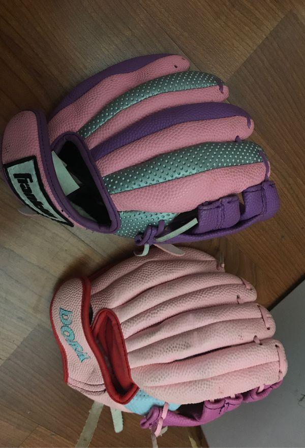 Two small girls baseball/softball gloves