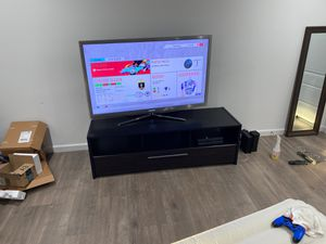 TV stand with 4 compartments on the bottom for Sale in Dallas, TX