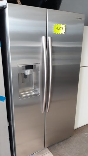 Stainless steel side by side refrigerator excellent condition for Sale in Laurel, MD