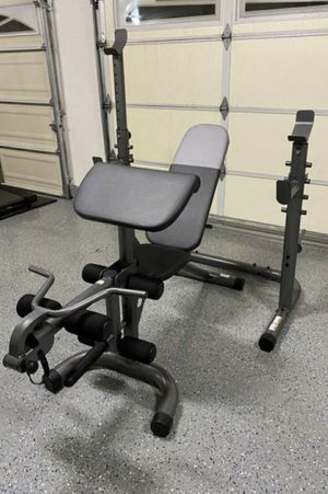 Squat rack with Olympic bench press adjustable with leg developer, preacher pad and attachment for Sale in Fullerton, CA