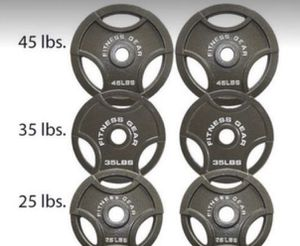 New set of Olympic Weight Plates, 3 pairs total 210 lbs. Reasonable offers considered. 3 pares de platos de pesas olímpicas, total de 210lbs for Sale in Miami, FL