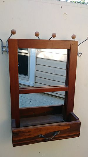 Solid oak antique mirror. It is NOT a coat hanger. Its just hanging on one to take the pic. for Sale in Fresno, CA