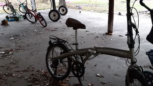 Gold fold up bike for Sale in Long Beach, MS