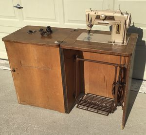 Vintage 1960's Singer embroider casement wood cabinet mechanical pedal sewing machine for Sale in Land O Lakes, FL