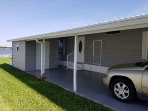 Be a Shareholder in this beautiful home with lake view under $100K! for Sale in Cypress Gardens, FL