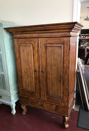 Real nice solid wood clothes armoire or TV armoire has three shelves lots of storage for Sale in Jacksonville, FL