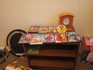 Tv stand with movies and clock for Sale in Heath, OH
