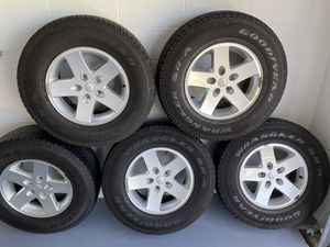 Jeep Wrangler wheels rims & tires (5) like new for Sale in Wahneta, FL