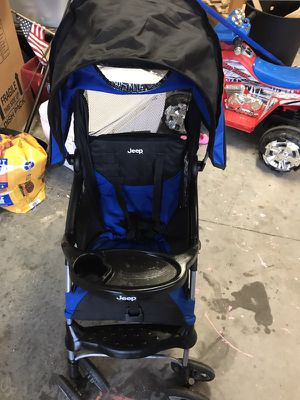 Black and blue jeep stroller for Sale in Jacksonville, NC