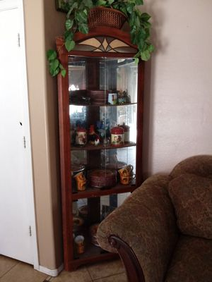 Curio cabinet with Light. for Sale in Phoenix, AZ