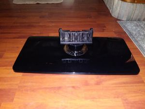 BRAND NEW SAMSUNG TV STAND IT STILL HAS THE PLASTIC AROUND THE NECK OF THE STAND for Sale in Montgomery, AL