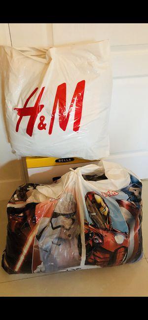 2 big bags with men's clothes USED in good conditions! Dos bolsas llenas de ropa para hombre usara en muy buenas condiciones Pantalones polos camisa for Sale in Fort Lauderdale, FL