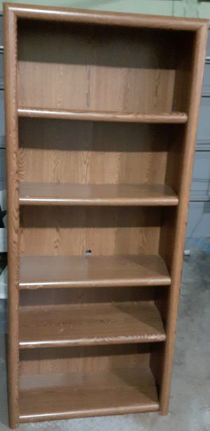 Very tall, solid bookcase ~ movable / adjustable shelves ~ oak tone for Sale in Fairview Park, OH
