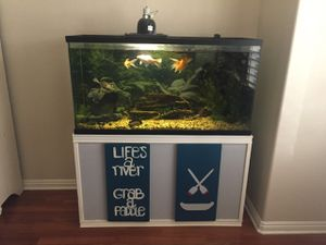 75 Gallon Aquarium with Stand, Filter, and River Rock for Sale in Glendale, AZ