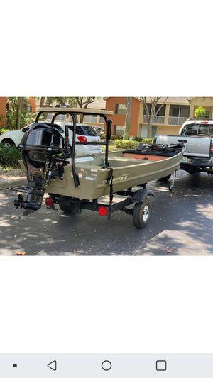 14 tracker 15hp merc /w trailer trolling motor polling platform and bass deck for Sale in Boynton Beach, FL