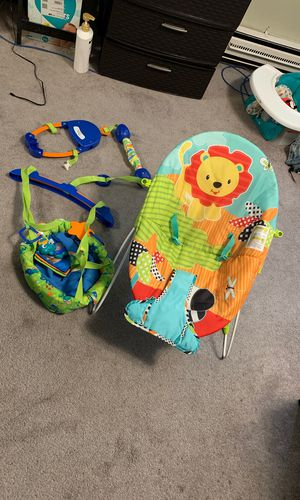 Swing that hang off the door and a baby chilling chair for Sale in Seattle, WA