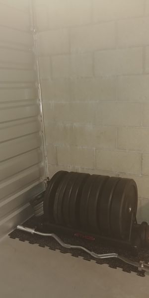Olympic bars and rubber weights for Sale in San Diego, CA