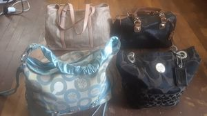 Two real Coach bags and Two real Michael Kors bags used but still nice $ 20 bucks EACH for Sale in Memphis, TN