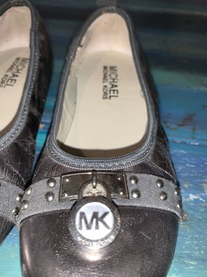 Michael Kors silver slip ons size 1 for Sale in Clayton, NC