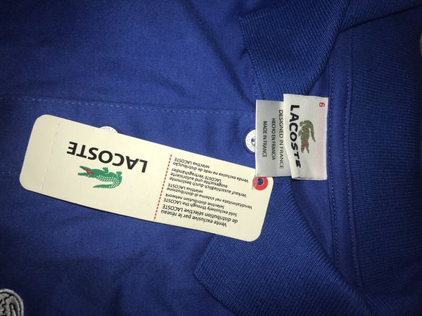 Brand new Lacoste blue polo size large