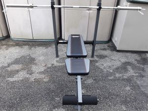 Great starter gym set : bench 4incline positions.. and 7ft 45lb olympic barbell . Can separate items for Sale in Baltimore, MD
