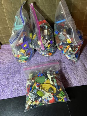 3 big bags of miscellaneous legos and a small bag of a mix of figure parts enough to make a lot of figures for Sale in Los Angeles, CA