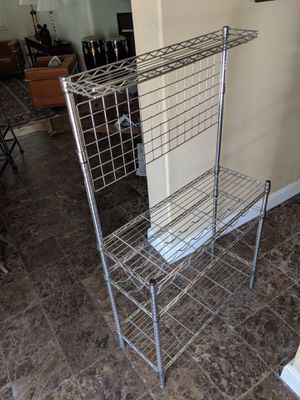Nice Bakers Rack work station. 36x15x63 tall Chrome plated open wire shelving, top shelf, tool utensil hanging grid backer. for Sale in Las Vegas, NV
