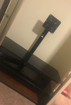 Heavy tv stand , glass shelf's and wood small scratches 50$ pick up will need truck or big car for Sale in Austin,  TX