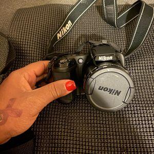 Nixon black Camera, With 4 G Sandisk for Sale in Homestead, FL